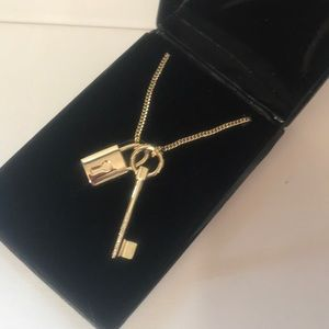 Gold necklace 38 inches lock& key